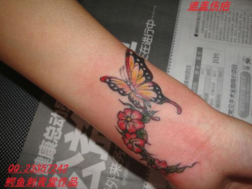 蝴蝶花纹身遮疤纹身