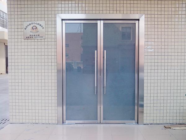 不锈钢玻璃地弹门