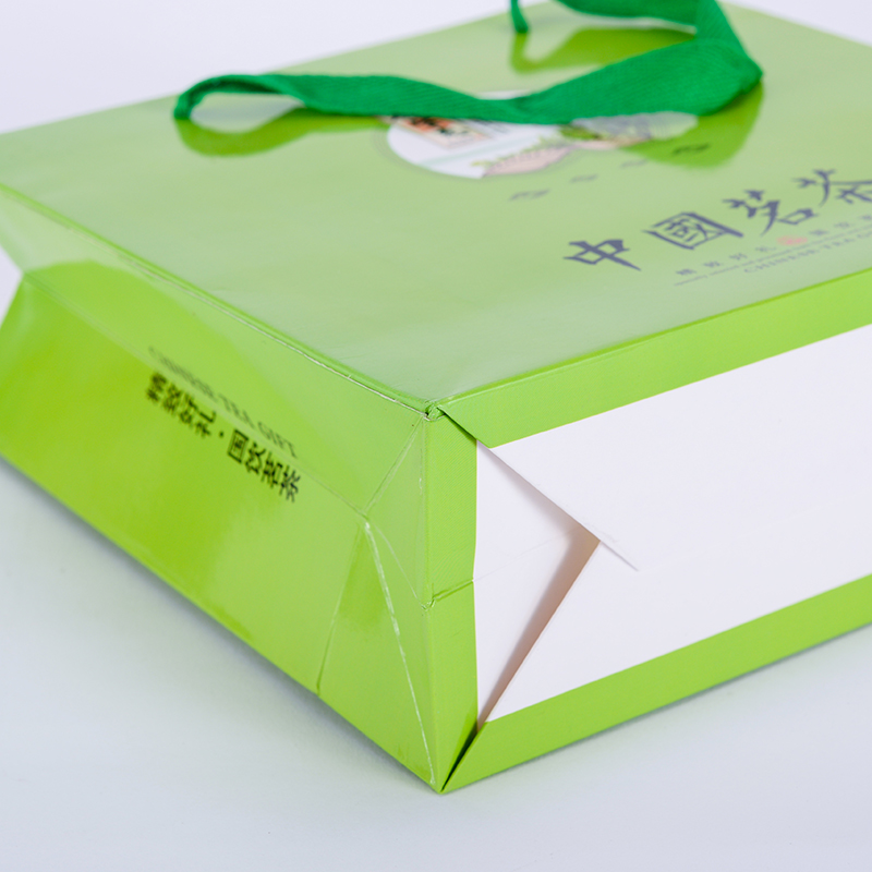 銅版紙質_啞光膜手挽紙袋產品貨源_駿越包裝
